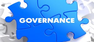 "Jigsaw piece graphic with the word ""Governance"""